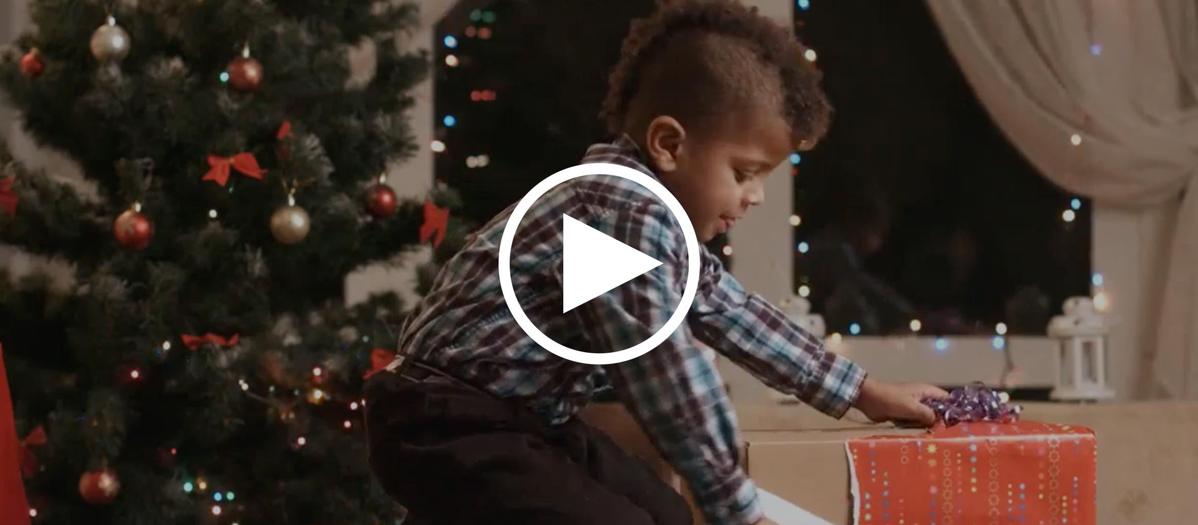 The Holiday Giving Program video - opens video lightbox