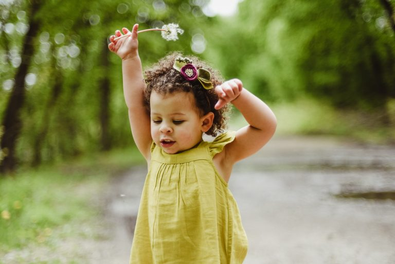 adorable hispanic girl blows bubbles