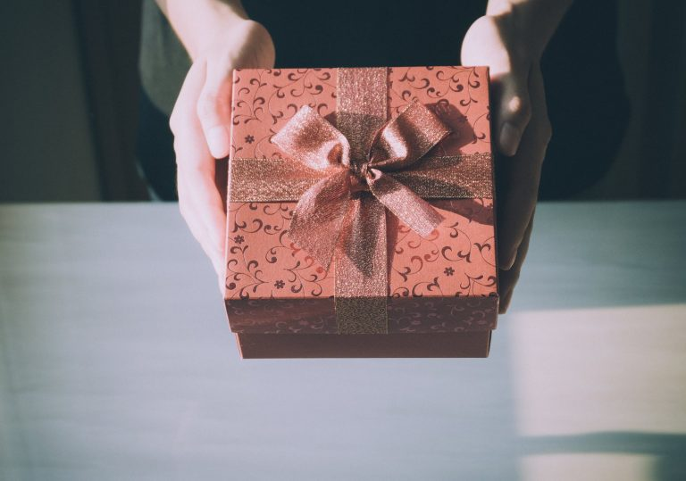 holding a small red gift